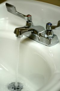 Bathroom sink faucet with water running