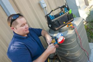 HVAC technician doing maintenance