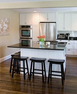 Remodeled kitchen island with stools around it